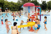 Picture of adults and water in a pool play area.